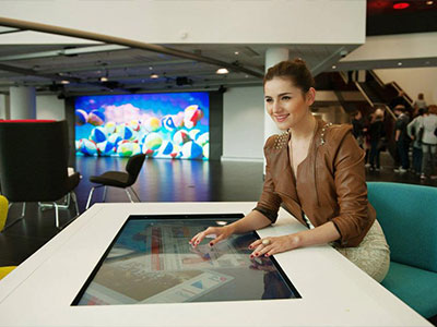 Woman Using Interactive Table